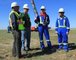(From left) Kirk Osadetz, CaMI Programs Development Manager; Don Lawton, CaMI Director; Dave Eaton, Geoscience Professor; and Xeuwei Bao, postdoctoral researcher, at field research station